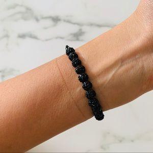 Black rhinestone cross bracelet